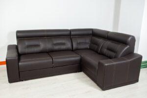 Angular Black Leather Sofa On A Neutral Background